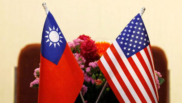 Flags of Taiwan and U.S. are placed for a meeting between U.S. House Foreign Affairs Committee Chairman Ed Royce speaks and with Su Chia-chyuan, President of the Legislative Yuan in Taipei, Taiwan March 27, 2018.  - Sputnik International