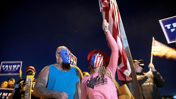 Mike and Wetonia Houlihan join other supporters of U.S. President Donald Trump during a Stop the Steal protest at the Clark County Election Center in North Las Vegas, Nevada, U.S. November 4, 2020. - Sputnik International