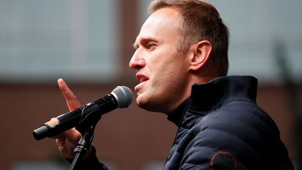 FILE PHOTO: Russian opposition leader Alexei Navalny delivers a speech during a rally to demand the release of jailed protesters, who were detained during opposition demonstrations for fair elections, in Moscow, Russia September 29, 2019 - Sputnik International