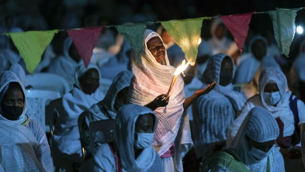 Ethiopian Orthodox Christians light candles and pray for peace during a church service at the Medhane Alem Cathedral in the Bole Medhanealem area of the capital Addis Ababa, Ethiopia Thursday, Nov. 5, 2020.  - Sputnik International