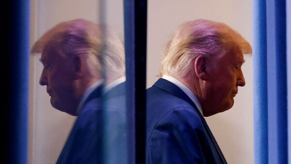 U.S. President Donald Trump is reflected as he departs after speaking about the 2020 U.S. presidential election results in the Brady Press Briefing Room at the White House in Washington, U.S., November 5, 2020. - Sputnik International