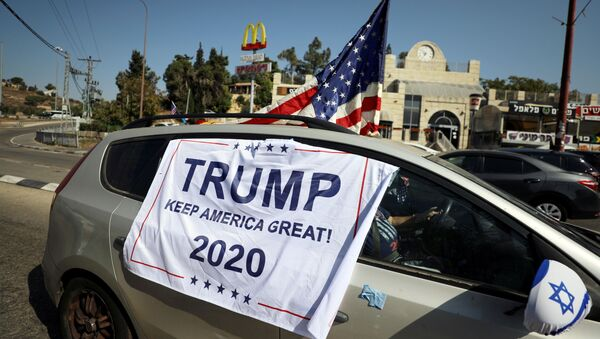 An American flag and banner cover a car, part of a convoy to the U.S. Embassy in Jerusalem to show support for U.S. President Donald Trump, ahead of the upcoming U.S. election, near Sho'eva, Israel October 27, 2020. REUTERS/Ammar Awad/File Photo - Sputnik International