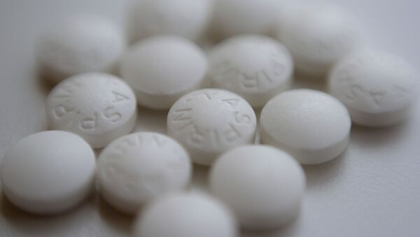 This Thursday, Aug. 23, 2018 file photo shows an arrangement of aspirin pills in New York. A new study suggests millions of people need to rethink their use of aspirin to prevent a heart attack. If you've already had a heart attack, doctors recommend taking a low-dose aspirin a day to prevent a second one. But if you don't yet have heart disease, doctors now advise routine aspirin can do more harm than good. - Sputnik International