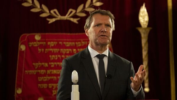 Rene de Reuver, speaking on behalf of the General Synod of the Protestant Church in the Netherlands, reads a statement at the Rav Aron Schuster Synagogue in Amsterdam, Netherlands, Sunday, Nov. 8, 2020.The Dutch Protestant Church made a far-reaching confession of guilt Sunday for its failure to do more to help Jews during and after World War II and even for the church's role in preparing the ground in which the seeds of anti-Semitism and hatred could grow. The statement came at a solemn ceremony to mark Monday's anniversary of the Nazis' anti-Jewish Kristallnacht, or Night of Broken Glass, pogrom in Germany and Austria.  - Sputnik International