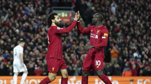 Liverpool's Mohamed Salah, front left, celebrates with Liverpool's Sadio Mane after scoring his side's opening goal during the English Premier League soccer match between Liverpool and Sheffield United at Anfield Stadium, Liverpool, England, Thursday, Jan. 2, 2020 - Sputnik International