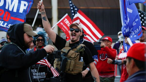 A supporter of US President Donald Trump yells during a Stop the Steal protest after the 2020 US presidential election was called for former Vice President Joe Biden, in front of the Maricopa County Tabulation and Election Center (MCTEC), in Phoenix, Arizona, 8 November 2020 - Sputnik International