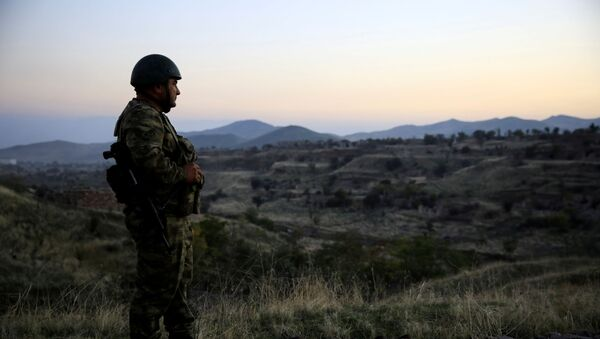 An Azeri soldier inspects the city of Cebrayil, where Azeri forces regained control during the fighting over the breakaway region of Nagorno-Karabakh, Azerbaijan October 16, 2020 - Sputnik International