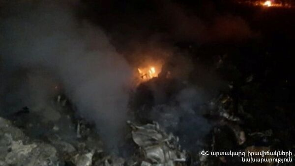 A view shows what is said to be a crash site following the downing of a Russian military Mi-24 helicopter at an unknown location in Armenia, in this handout photo released November 9, 2020. Ministry of Emergency Situations of the Republic of Armenia - Sputnik International