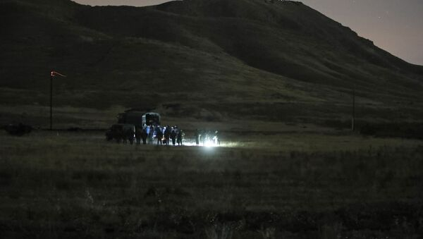 Armenian and Russian soldiers search the site of wreckage of a downed Russian military helicopter which was shot down in Armenia near the border with Azerbaijan, near Eraskh, Armenia, Monday, Nov. 9, 2020. - Sputnik International
