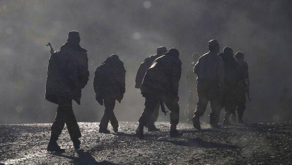 Ethnic Armenian soldiers walk along the road near the border between Nagorno-Karabakh and Armenia, Sunday, 8 November 2020. - Sputnik International