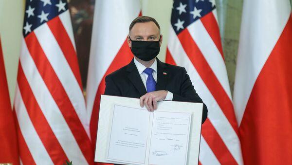 Polish President Andrzej Duda ratifies the Poland–United States Enhanced Defense Cooperation Agreement (EDCA) in Warsaw on November 10, 2020 - Sputnik International