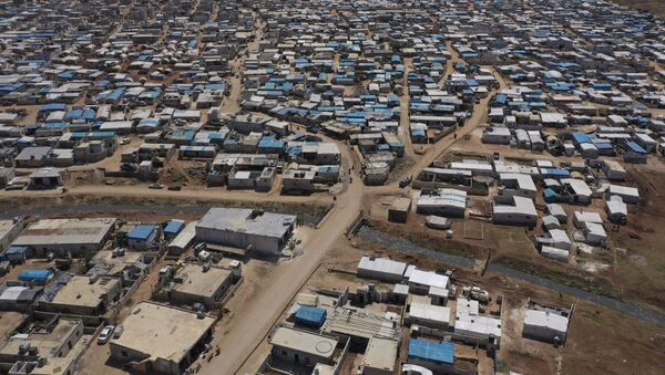 This April 19, 2020 file photo shows a large refugee camp on the Syrian side of the border with Turkey, near the town of Atma, in Idlib province, Syria - Sputnik International