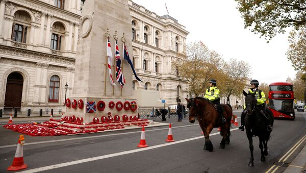 Mounted police officers pass the Cenotaph with wreaths on it in Whitehall, London, England, 11 November 2020. - Sputnik International