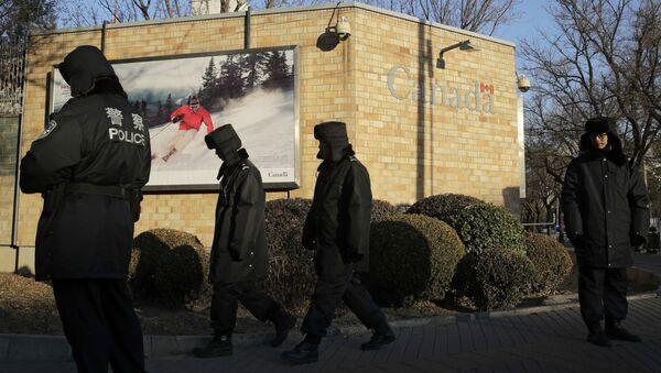 Policemen patrol outside the Canadian Embassy in Beijing, Wednesday, Dec. 12, 2018 - Sputnik International