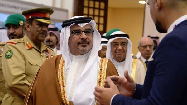 First Deputy Prime Minister and Crown Prince of the Kingdom of Bahrain Salman bin Hamad al-Khalifa (centre) at the BIDEC-2017 international defence exhibition in Bahrain. - Sputnik International