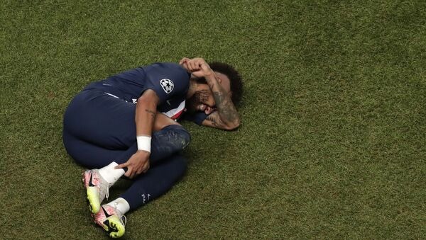 In this Sunday, Aug. 23, 2020 file photo, PSG's Neymar lies on the ground during the Champions League final soccer match between Paris Saint-Germain and Bayern Munich at the Luz stadium in Lisbon, Portugal - Sputnik International