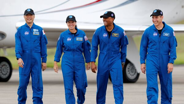 NASA astronauts Shannon Walker, Victor Glover, Mike Hopkins, and JAXA (Japan Aerospace Exploration Agency) and astronaut Soichi Noguchi, who comprise Crew-1, walk at Kennedy Space Center ahead of the NASA/SpaceX launch of the first operational commercial crew mission in Cape Canaveral, Florida, 8 November 2020 - Sputnik International