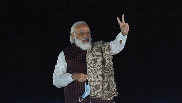 India's Prime Minister Narendra Modi gestures during the celebrations after the victory in Bihar assembly election and by-election in other states at the Bharatiya Janata Party (BJP) headquarters in New Delhi on November 11, 2020 - Sputnik International