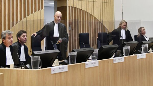 Judge Hendrik Steenhuis arrives to attend the hearing in trial of the Malaysia Airlines flight MH17 on September 28, 2020 in the high-security courtroom of the Schiphol Judicial Complex, in Badhoevedorp, where the lawsuit about the downing of flight MH17 continues.  - Sputnik International