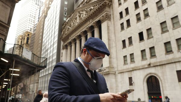 A man wears a protective mask as he walks past the New York Stock Exchange on the corner of Wall and Broad streets during the coronavirus outbreak in New York City, New York, U.S., March 13, 2020 - Sputnik International