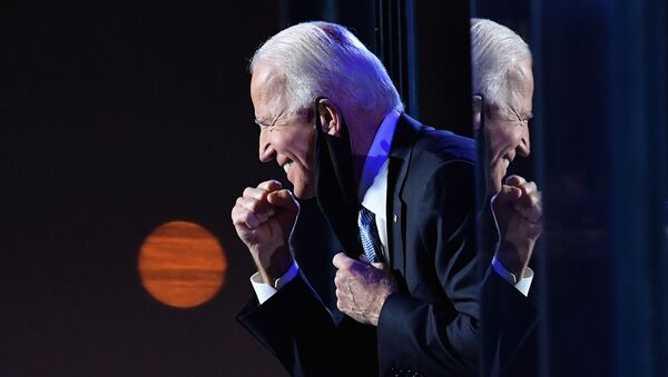 The US Democratic presidential candidate Joe Biden gestures to the crowd after he delivered remarks in Wilmington, Delaware, on November 7, 2020. - Sputnik International