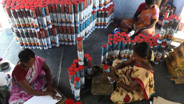 In this photograph, taken on 14 October 2019, workers produce firecrackers at a manufacturing unit involved in the production of different varieties of firecrackers ahead of the Hindu festival of Diwali, in Sivakasi - Sputnik International