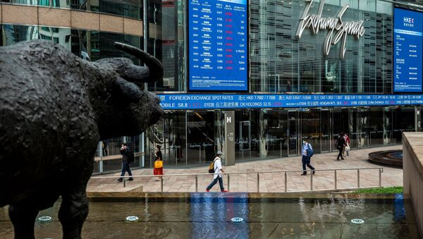 Electronic boards display various stock prices at Exchange Square in Hong Kong on March 9, 2020 - Sputnik International