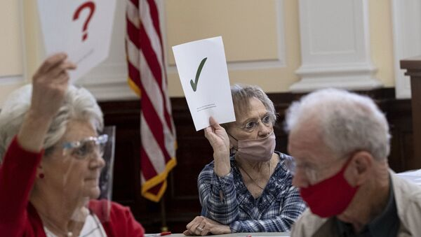 Officials sort ballots during an audit at the Floyd County administration building in Rome, Ga., on Friday morning, Nov. 13, 2020. Election officials in Georgia's 159 counties are undertaking a hand tally of the presidential race that stems from an audit required by state law. - Sputnik International