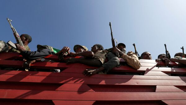 FILE PHOTO: Members of Amhara region militias ride on their truck as they head to the mission to face the Tigray People's Liberation Front (TPLF), in Sanja, Amhara region near a border with Tigray, Ethiopia November 9, 2020. - Sputnik International