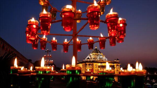 Illuminated Akshardham temple is seen on the eve of Diwali, the Hindu festival of lights, amidst the spread of COVID-19, in Gandhinagar, India, 13 November 2020.  - Sputnik International