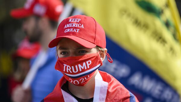 Supporters of US President Donald Trump look on in front of the White House as they gather near counter-protesters in Washington, DC on 13 November 2020. - Sputnik International