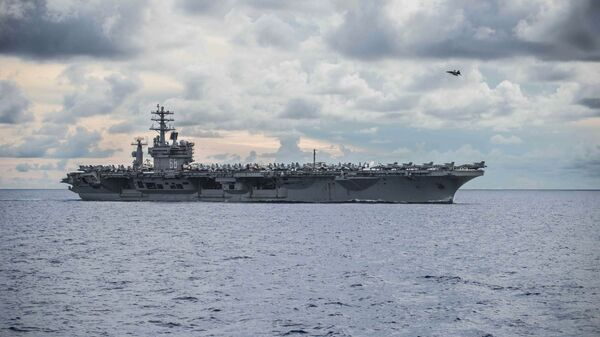 In this photo provided by U.S. Navy, USS Nimitz (CVN 68) steams alongside the Navy's only forward-deployed aircraft carrier USS Ronald Reagan (CVN 76, not in photo) in the South China Sea, Monday, July 6, 2020. - Sputnik International