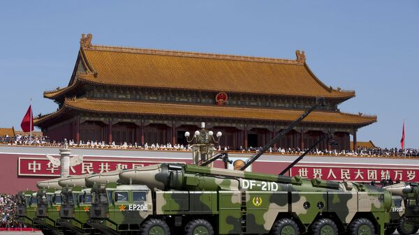 """In this Sept. 3, 2015, file photo, Chinese military vehicles carrying DF-21D anti-ship ballistic missiles, potentially capable of sinking a U.S. Nimitz-class aircraft carrier in a single strike, pass by Tiananmen Gate during a military parade to commemorate the 70th anniversary of the end of World War II, in Beijing. China's military test-fired two missiles into the South China Sea, including a """"carrier killer"""" military analysts suggest might have been developed to attack U.S. forces, a newspaper reported Thursday, Aug. 27, 2020. - Sputnik International"""