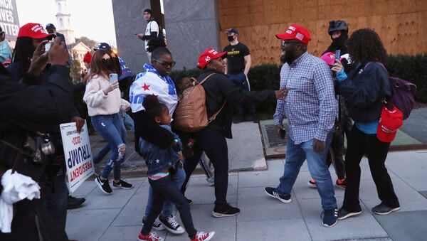 Supporters of U.S. President Donald Trump try to stop a fellow supporter from engaging as they walk past anti-Trump protesters, after the 2020 U.S. presidential election was called for Democratic candidate Joe Biden, in Washington, U.S. November 14, 2020. - Sputnik International