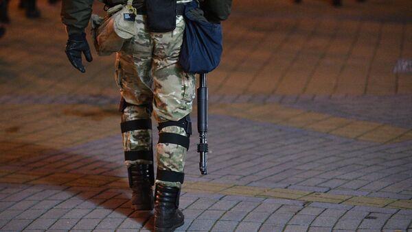 A law enforcement officer during an unathoirized rally in Minsk, Belarus - Sputnik International