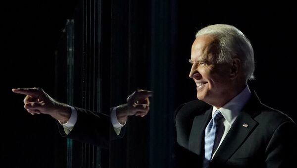 President-elect Joe Biden points a finger at his election rally in Wilmington, Delaware, November 7. REUTERS/Kevin Lamarque - Sputnik International