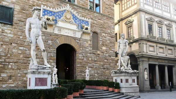 Copy of Michelangelo's David is seen at the entrance of Palazzo Vecchio  in Florence, Italy. File photo - Sputnik International