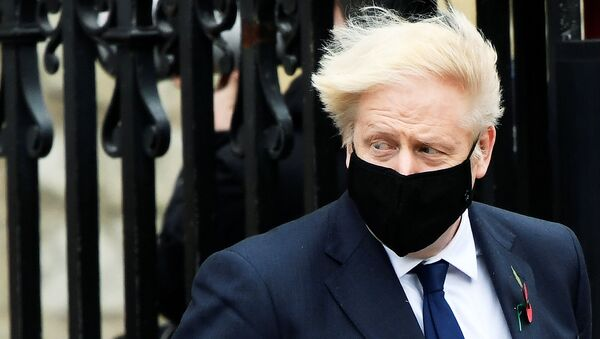Britain's Prime Minister Boris Johnson wearing a face mask leaves the Westminster Abbey following a remembrance service on Armistice Day in London, Britain, November 11, 2020. - Sputnik International