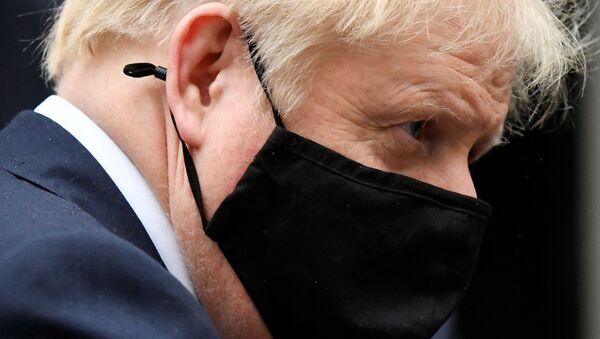 Britain's Prime Minister Boris Johnson, wearing a protective mask, leaves 10 Downing Street in London, Britain October 21, 2020 - Sputnik International