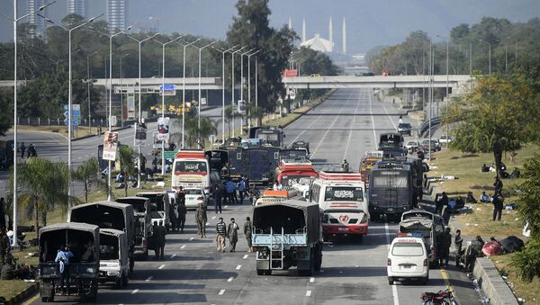 Security forces vehicles are seen along the blocked Islamabad-Rawalpindi highway during an anti-France demonstration by activists and supporters of the Tehreek-e-Labbaik Pakistan (TLP), a religious party, in Islamabad on November 16, 2020. - Pakistan authorities sealed off a major road into the capital Islamabad for a second day on November 16 as a far-right religious party held fresh anti-France protests. - Sputnik International