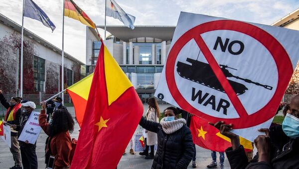 Pro-Tigrayan demonstrators display placards during a protest in front of the Chancellery in Berlin on November 12, 2020, over a week-old conflict in northern Ethiopia between the regional ruling party, the Tigray People's Liberation Front (TPLF), and the government of Prime Minister Abiy Ahmed. - Sputnik International