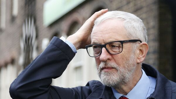 Britain's Labour party leader Jeremy Corbyn leaves after a press conference on the coronavirus, outside the Finsbury Park Jobcentre, in north London,  Sunday, March 15, 2020. - Sputnik International