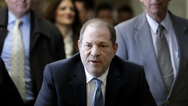 In this 24 February, 2020, file photo, Harvey Weinstein arrives at a Manhattan courthouse as jury deliberations continue in his rape trial in New York. The disgraced Hollywood film mogul and convicted rapist is asking a bankruptcy judge in Delaware to allow him to pursue arbitration in New York over what he claims is his wrongful termination from the company he co-founded. - Sputnik International