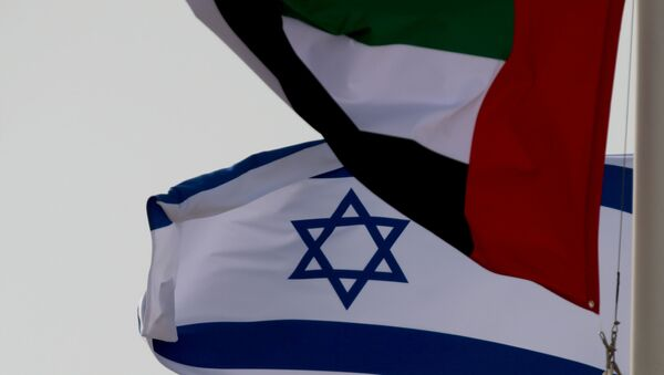 FILE PHOTO: Emirati and Israeli flags fly upon the arrival of Israeli and U.S. delegates at Abu Dhabi International Airport, in Abu Dhabi, United Arab Emirates August 31, 2020 - Sputnik International