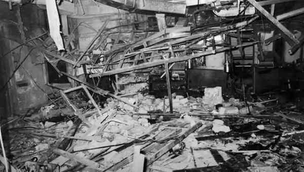 Screenshot captures wreckage from inside The Mulberry Bush pub, one of the two establishments which were bombed in Birmingham, England, in November 1974. - Sputnik International