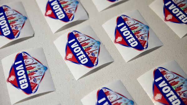 I Voted stickers are seen at a polling location where Hyla Winters works in Las Vegas, Nevada, U.S., October 29, 2020. Picture taken October 29, 2020. - Sputnik International