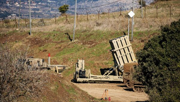 An Iron Dome anti-missile system is seen near the border area between Israel and Syria, in the Israeli-occupied Golan Heights, 18 November 2020. - Sputnik International