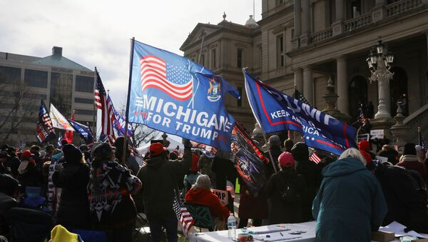 Supporters of U.S. President Donald Trump participate in a Stop the Steal protest after the 2020 U.S. presidential election was called for Democratic candidate Joe Biden, in Lansing, Michigan, U.S. 14 November 2020. - Sputnik International