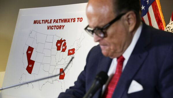 Former New York City Mayor Rudy Giuliani, personal attorney to U.S. President Donald Trump, stands in front of a map of election swing states marked as Trump Pathways to Victory during a news conference about the 2020 U.S. presidential election results held at Republican National Committee headquarters in Washington, U.S., November 19, 2020 - Sputnik International