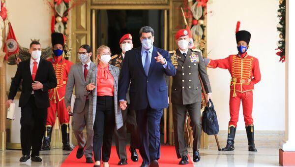 Venezuela's President Nicolas Maduro walks before holding a virtual news conference in Caracas, Venezuela October 28, 2020. - Sputnik International